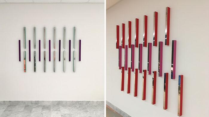Två verk som både består av strama rektangulära former i starka färger som bildar mönster på väggen.
